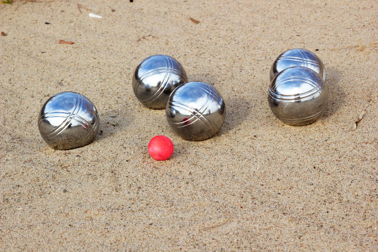 Petanque balls on the sandy beach